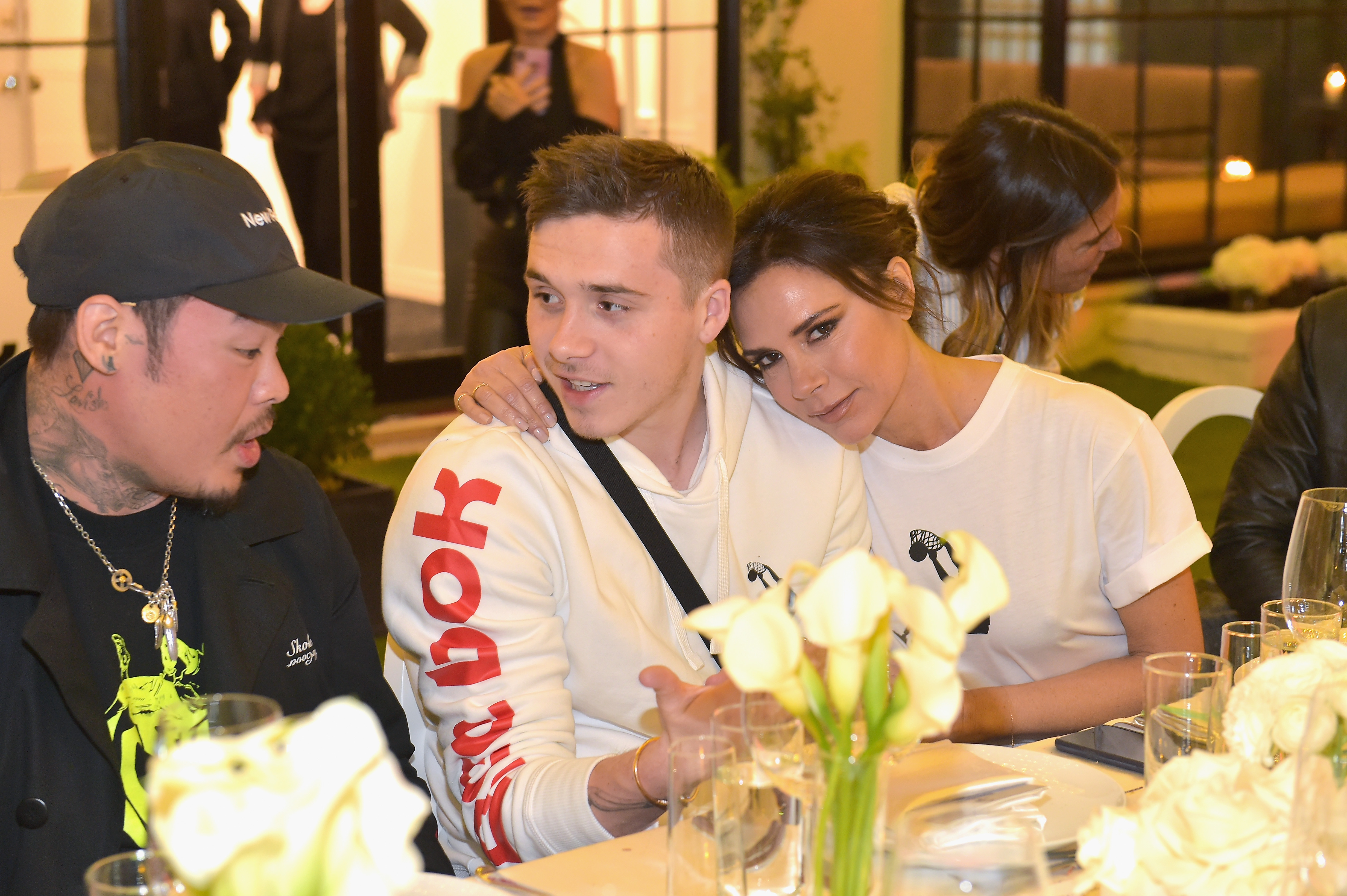 Brooklyn Beckham and Victoria Beckham an event celebrating Reebok and Victoria Beckham celebrate their partnership. Special guest Shaquille O'Neal officially welcomes Victoria to the Reebok Team at The House on Sunset on April 12, 2018 in Beverly Hills, California. (Photo by Donato Sardella/Getty Images for Reebok) *** Local Caption *** Dr. Woo, Brooklyn Beckham;Victoria Beckham