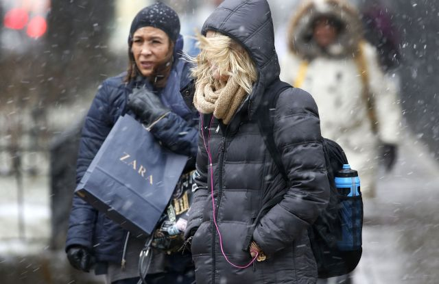 Shoppers on Chicago's Magnificent Mile endure blowing snow and high winds off Lake Michigan as a winter storm begins in the greater Chicago and northwest Indiana area, in Chicago. The storm is moving through parts of the Midwest stretching from Missouri northeast through Illinois, Indiana and Michigan, with blizzard warnings for counties in eastern Illinois and northwestern IndianaWinter Weather, Chicago, USA