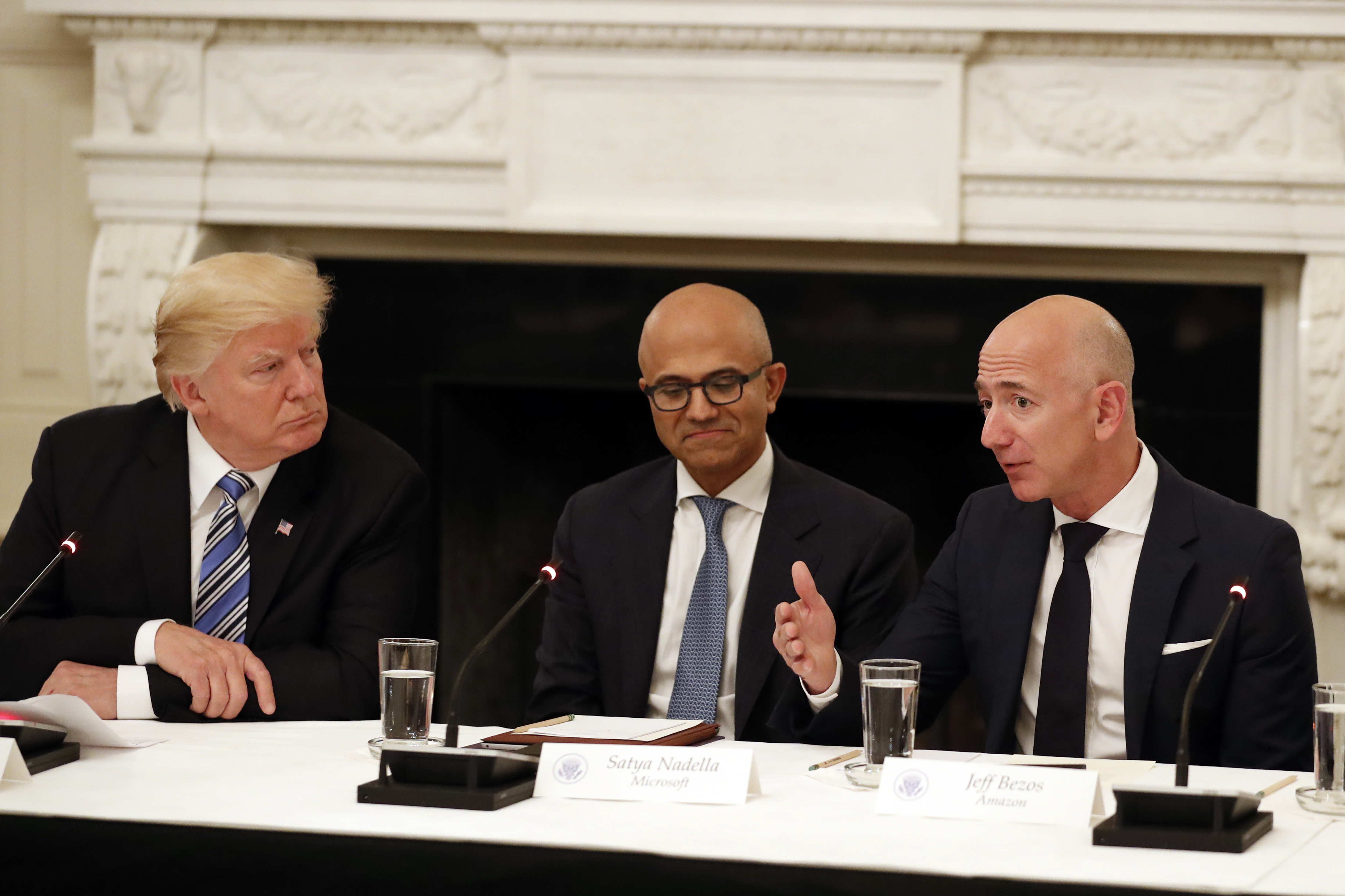 Donald Trump, Tim Cook, Satya Nadella, Jeff Bezos President Donald Trump, left, and Satya Nadella, Chief Executive Officer of Microsoft, center, listen as Jeff Bezos, Chief Executive Officer of Amazon, speaks during an American Technology Council roundtable in the State Dinning Room of the White House, in WashingtonTrump Technology, Washington, USA - 19 Jun 2017