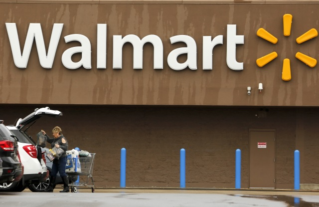 A shopper loads her car after shopping at a Walmart in PittsburghWalmart, Pittsburgh, USA - 22 Feb 2018