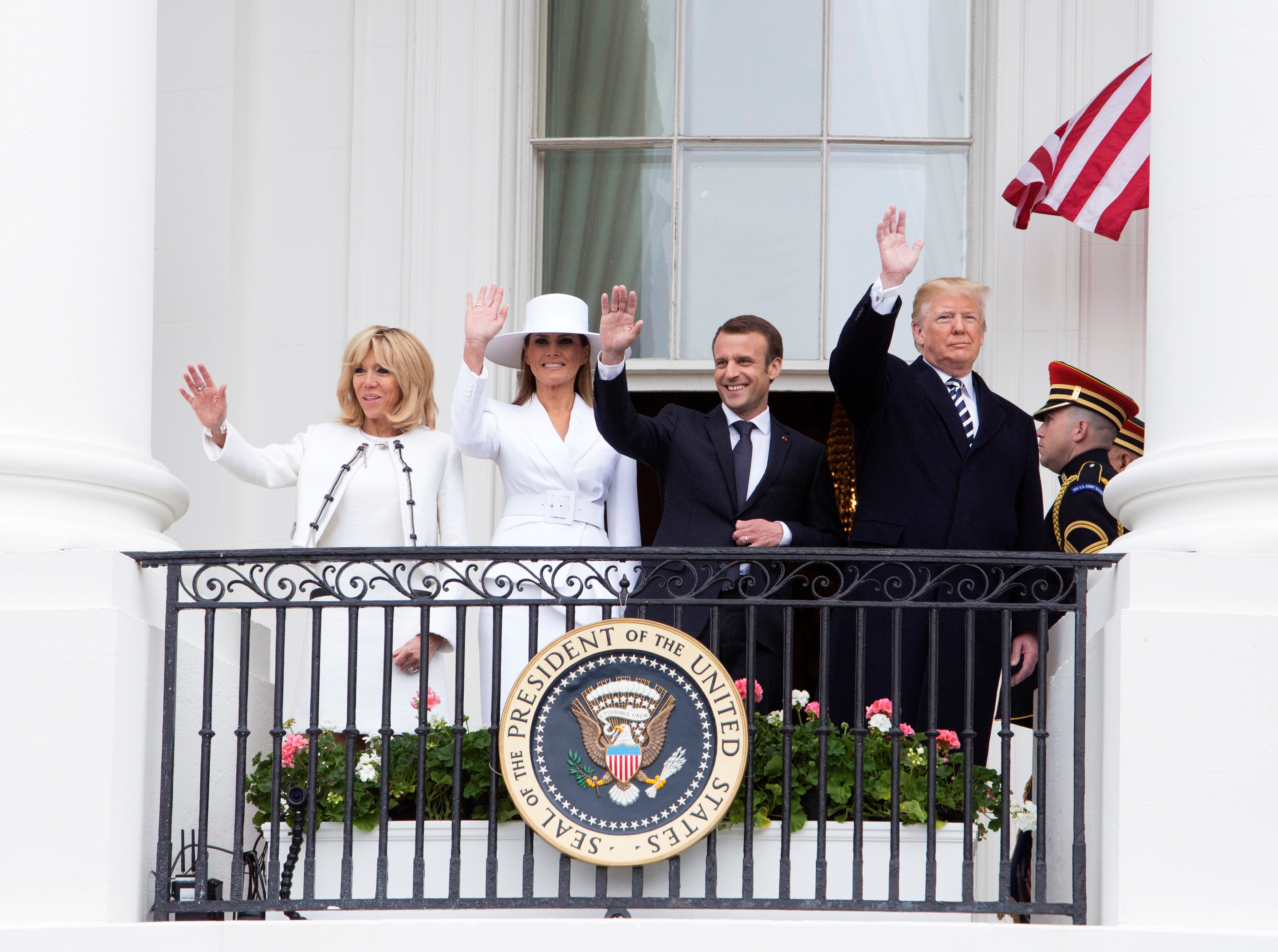 US President Donald J. Trump (R), his wife Melania Trump (2-L), French President Emmanuel Macron (2-R) and his wife Brigitte Macron wave from a balcony at the White House in Washington, DC, USA, 24 April 2018. President Macron will be in DC for three days for a state visit at the White House and an address to a joint session of Congress on 25 April.French President Macron visits USA, Washington - 24 Apr 2018