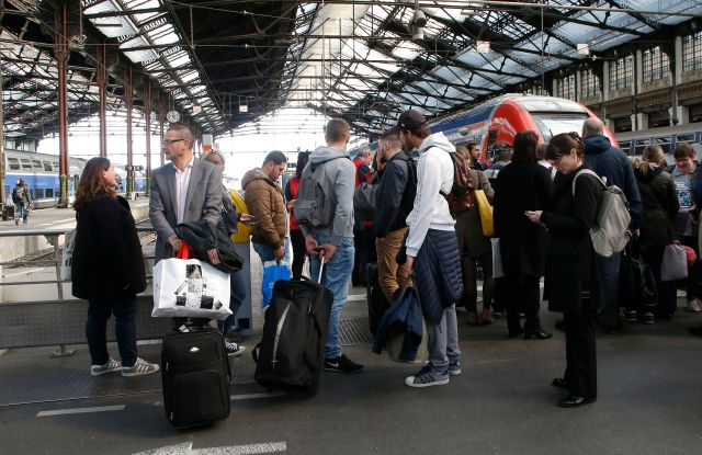 Passengers waiting at Gare de Lyon train station in Paris.