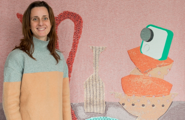 """Kiki van Eijk with one of her """"Softwear"""" wallhangings for Google's installation."""