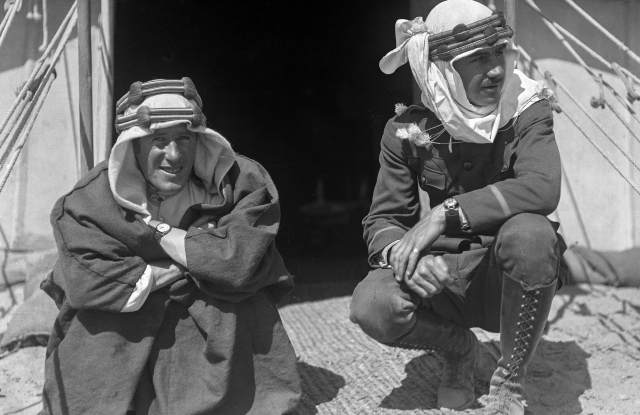 """T.E. Lawrence, better known as """"Larence of Arabia"""" (seated) with Lowell Thomas."""