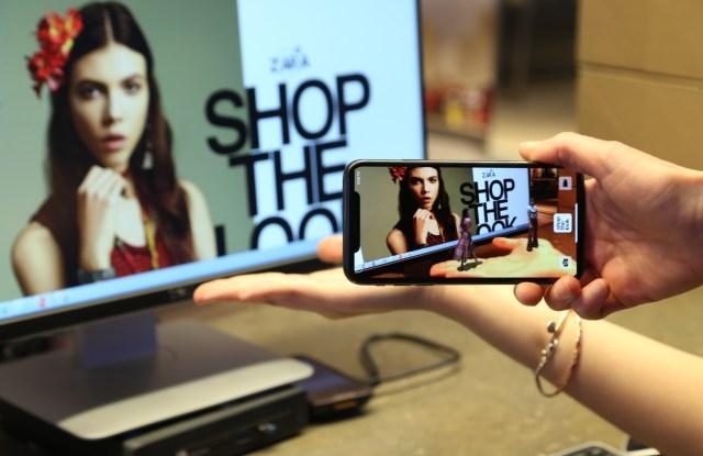 Zara's AR experience in front of a desktop.