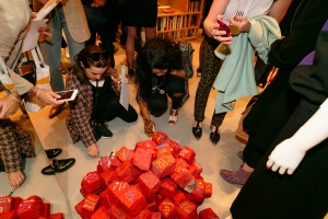Partygoers decorate cobblestones at Sonia Rykiel's Pavé celebration