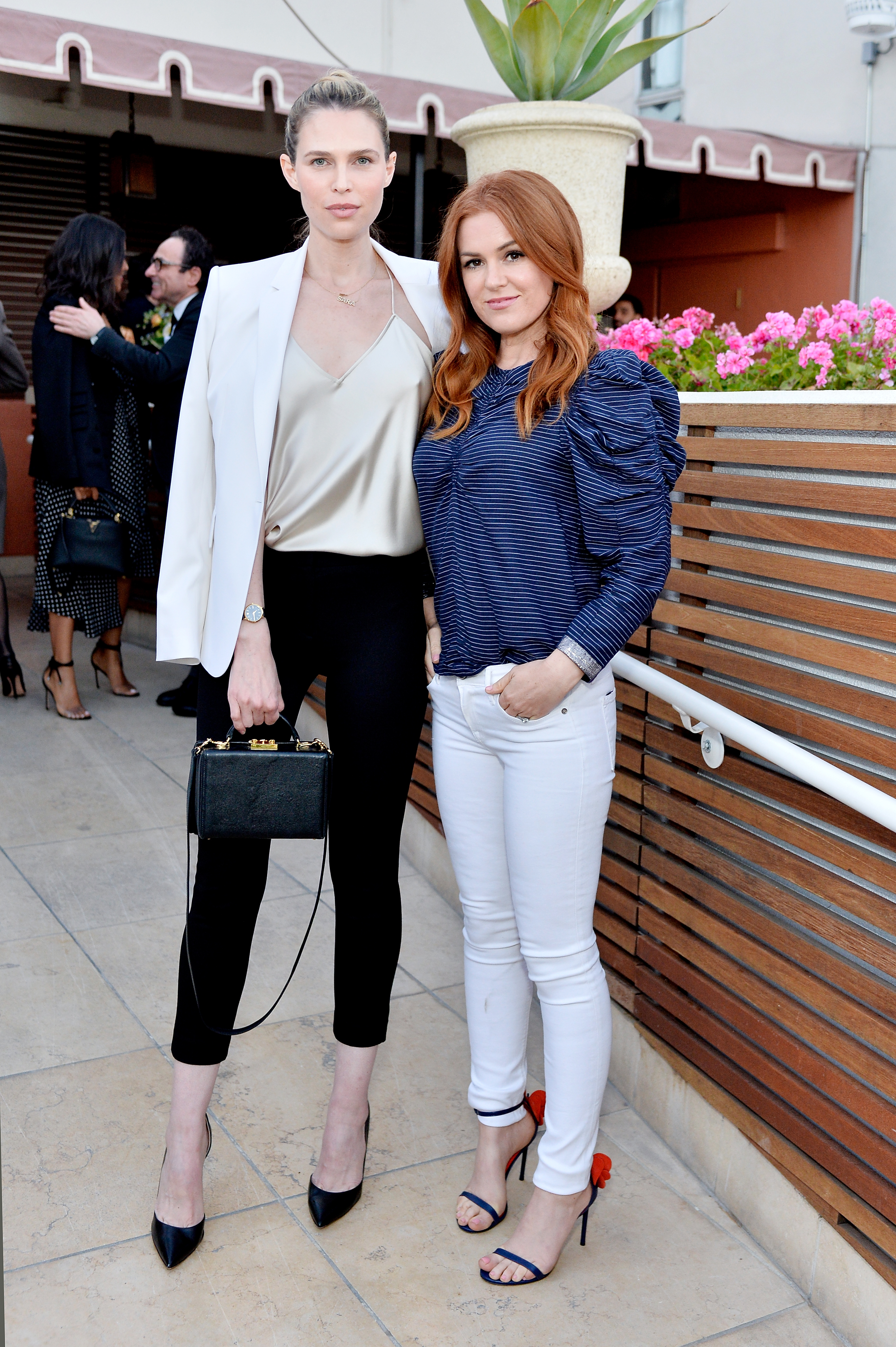 Sara Foster and Isla Fisher attend Aerin Lauder Dinner in Celebration of the AERIN SS18 Collection by Williams Sonoma at Sunset Tower Hotel on May 9, 2018 in West Hollywood, California. (Photo by Stefanie Keenan/Getty Images for AERIN)