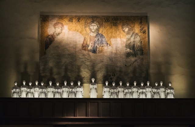An installation of choir robes on view at The Met.