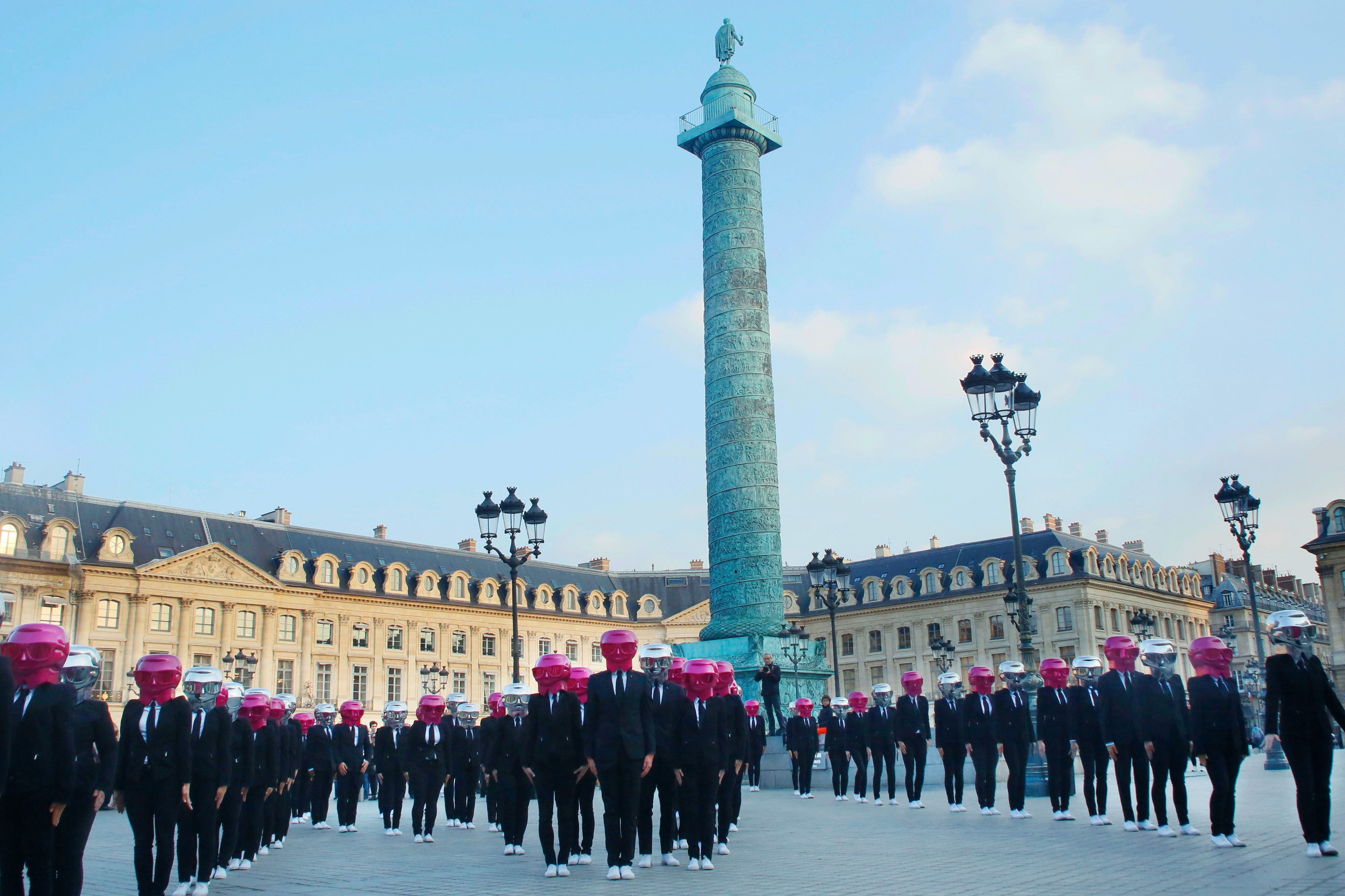 Performers dance wearing Karl Lagerfeld masks on Place Vendome to mark the launch of the Karl Lagerfeld + ModelCo makeup product line in Paris, FranceKarl Lagerfeld x ModelCo launch event, Paris, France - 15 May 2018