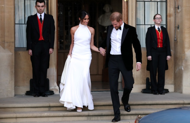 The newly married Duke and Duchess of Sussex, Meghan Markle and Prince Harry, leaving Windsor Castle after their wedding to attend an evening reception at Frogmore HouseThe wedding of Prince Harry and Meghan Markle, Open-top car, Windsor, Berkshire, UK - 19 May 2018