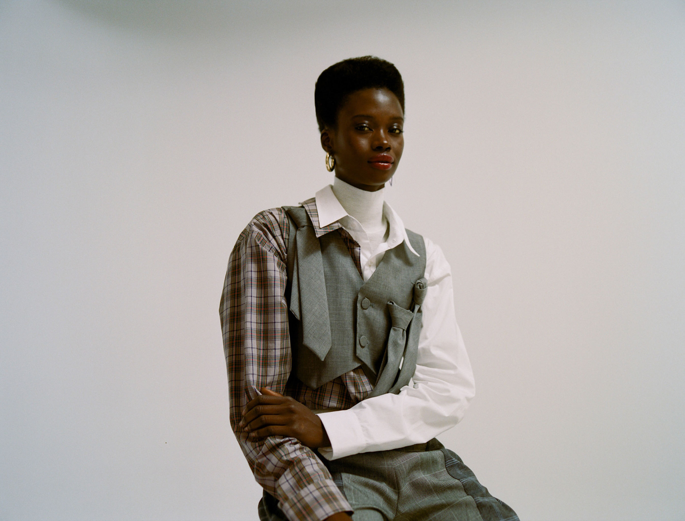 Vaquera's cotton shirt and wool waistcoat over Gabriele Colangelo's wool turtleneck; Chelsea and Walker's cotton, linen, polyester, rayon and spandex pants. Jennifer Fisher earring.