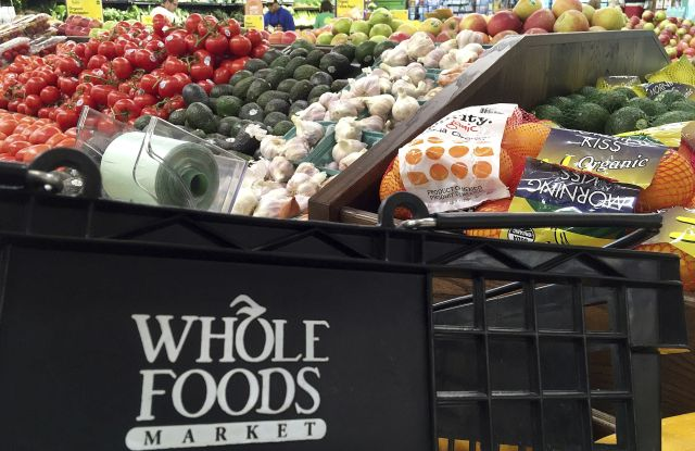 This, photo, shows produce displayed at Whole Foods Market in Andover, Mass. Amazon is buying Whole Foods in a deal valued at about $13.7 billion. The two companies have not yet detailed how their proposed union might change the experience for customers. But the deal has the potential to boost the outsized ambitions of Amazon CEO Jeff Bezos and Whole Foods chief John Mackey, each of whom has already radically altered the way Americans shopAmazon-Whole Foods-Ambitions, Andover, USA - 05 Jun 2017