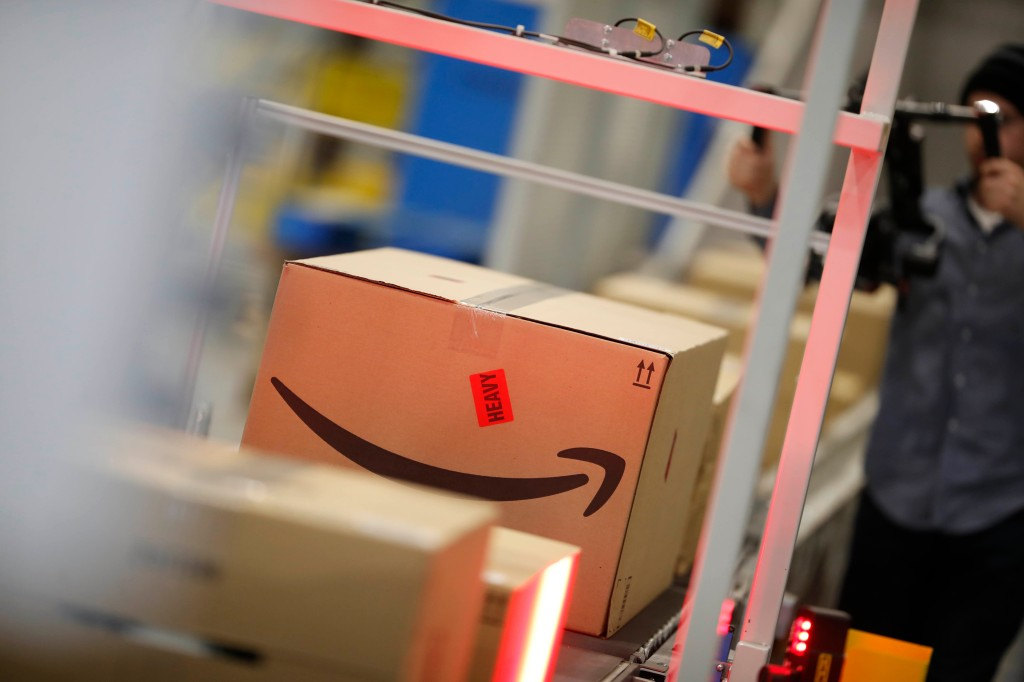 Amazon fulfillment center in Aurora, Colo. Boxes move down a conveyor belt during a tour of the Amazon fulfillment center, in Aurora, Colo. More than 1,000 full-time associates work in the Aurora facility, which opened in September 2017, and is one of more than 100 such fulfillment centers scattered across North AmericaAmazon Colorado - 03 May 2018