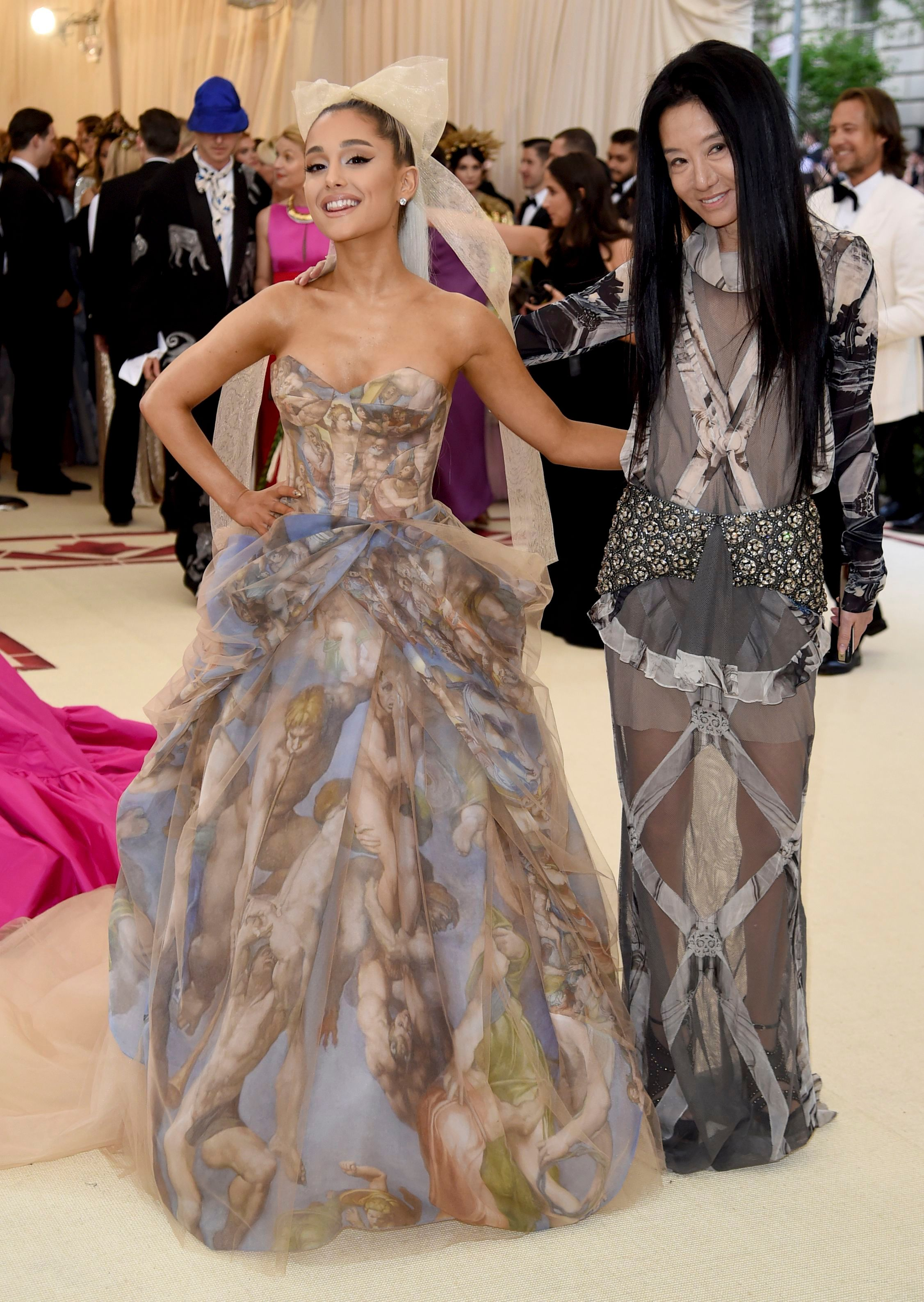 Ariana Grande, Vera Wang. Ariana Grande, left and Vera Wang attend The Metropolitan Museum of Art's Costume Institute benefit gala celebrating the opening of the Heavenly Bodies: Fashion and the Catholic Imagination exhibition, in New York2018 MET Museum Costume Institute Benefit Gala, New York, USA - 07 May 2018