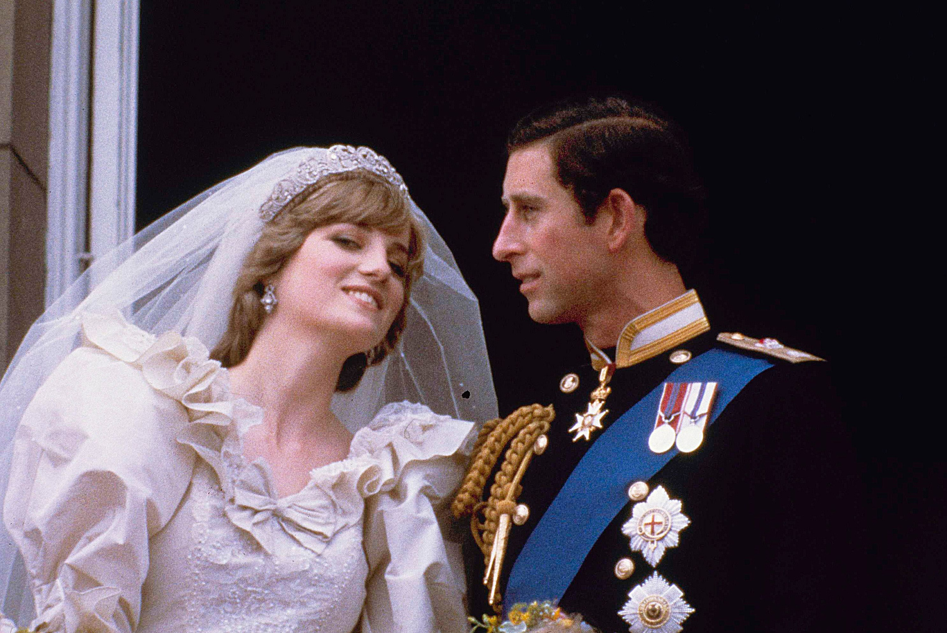 Prince Charles and his bride Diana, Princess of Wales, are shown on their wedding day on the balcony of Buckingham Palace in London