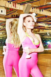 Tracy Anderson in a neon pink bodysuit and leggings from the Heroine x Tracy Anderson collection.