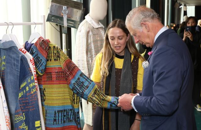 Prince Charles pays a visit in 2018 to White City House in London to support sustainable designers and brands.
