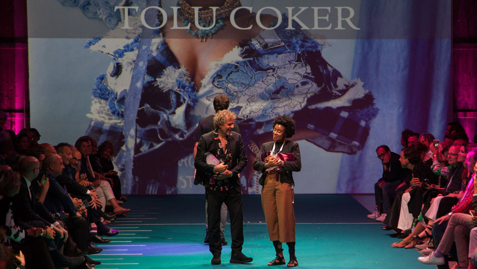 Renzo Rosso bestows Tolu Coker with the Diesel Award at ITS 16th edition.