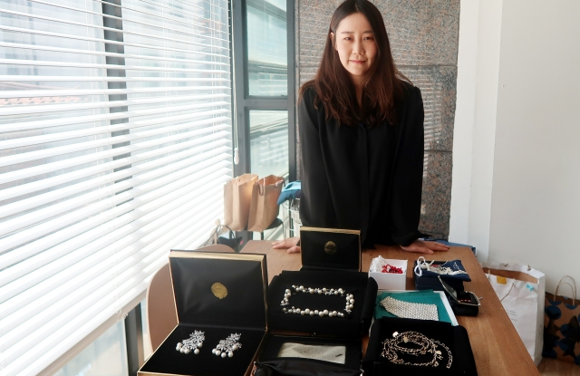 Choi Kyoung Won in her Seoul office with jewelry selected for Blackpink.