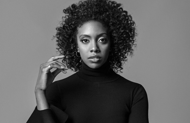Condola Rashad in Valentino's viscose and polyester turtleneck and Tibi's wool pants. Paige Novick earrings and Established Jewelry rings.