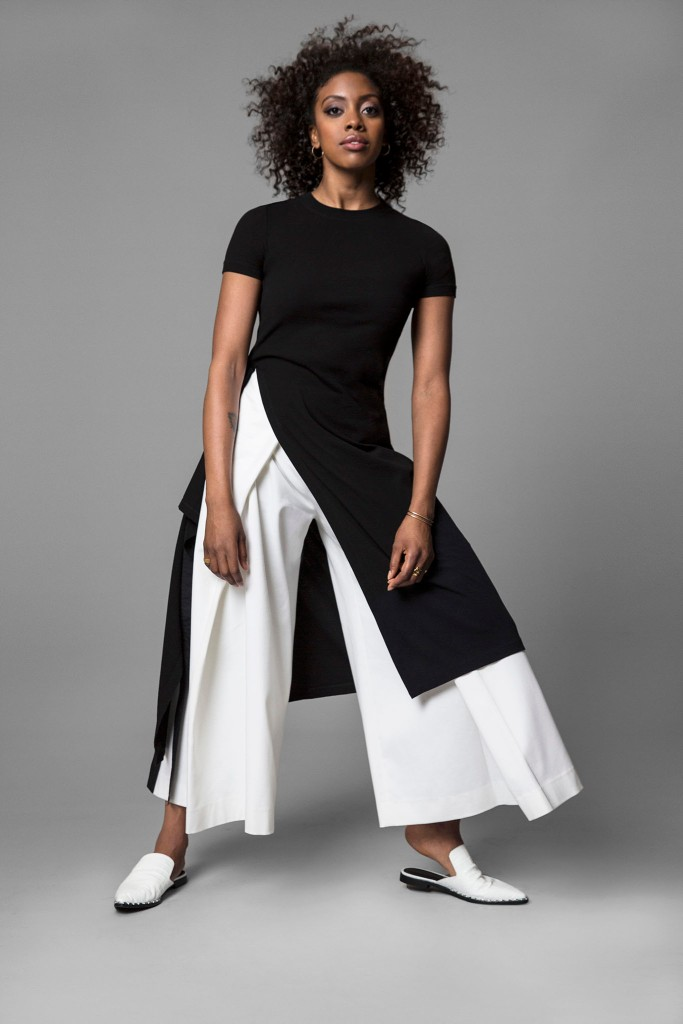 Condola Rashad in Rosetta Getty's black cotton dress over Rosetta Getty's white cotton pants. Paige Novick necklace and earrings, Established Jewelry rings and Sigerson Morrison shoes.
