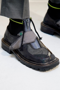 A shoe from the CMMN brand.