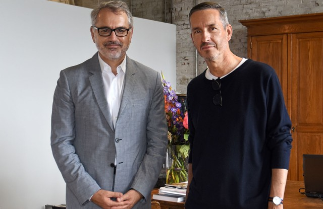 Marc Puig and Dries Van Noten in the designer's office in Antwerp.