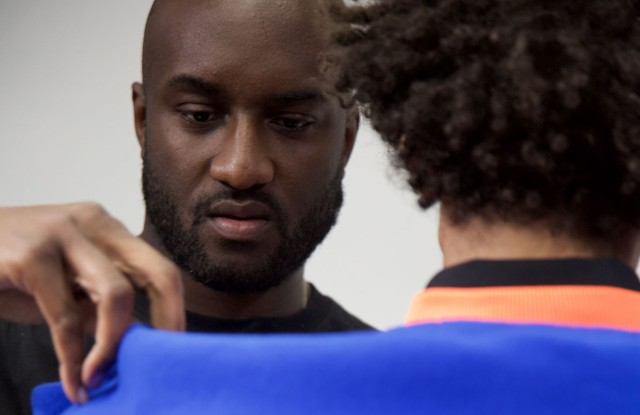 Virgil Abloh fitting a model in a Spring 2019 look.