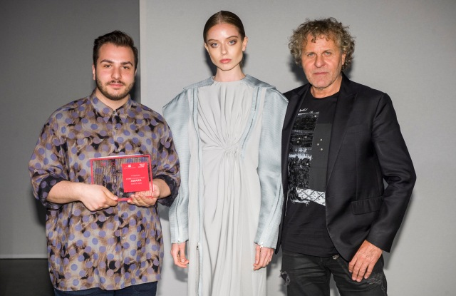 Mauro Muzio Medaglia receiving the award from OTB Renzo Rosso.