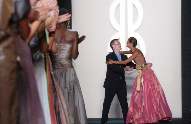 Michael Vollbracht, center, embraces a model after the Bill Blass spring 2004 collection, which featured his designs, during the Mercedes Benz Fashion Week in New YorkFASHION BLASS, NEW YORK, USA