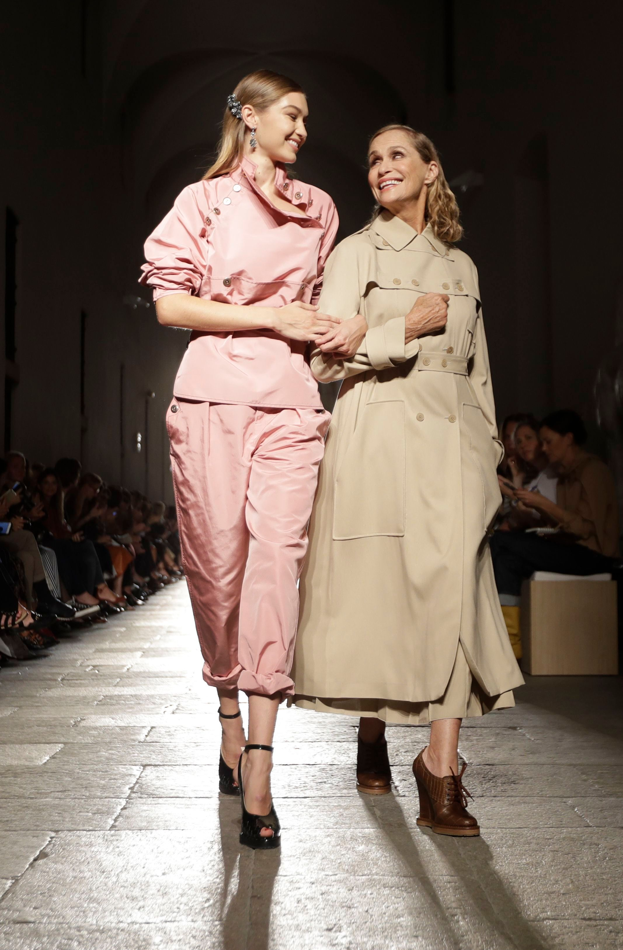 Model Gigi Hadid, left, is flanked by model and actress Lauren Hutton as they take the catwalk for Bottega Veneta women's Spring-Summer 2017 collection, presented in Milan, ItalyBottega Veneta show, Spring Summer 2017, Milan Fashion Week, Italy - 24 Sep 2016