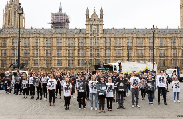 Fur activists stage a silent protest outside Parliament