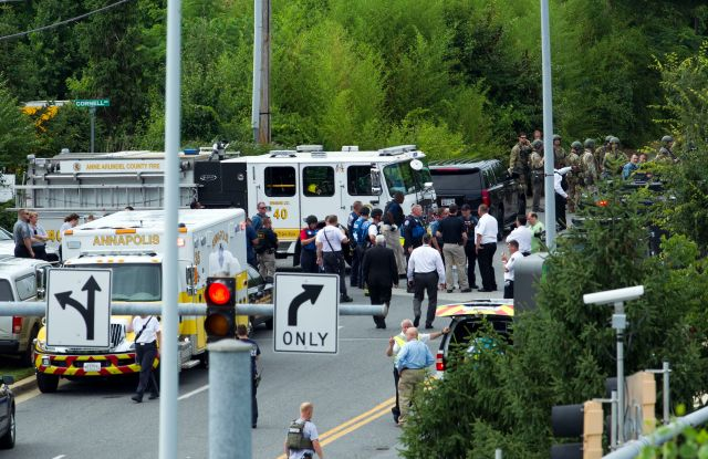 Authorities stage at the building entrance after multiple people were shot at The Capital Gazette newspaper in Annapolis, MdShootings Newspaper, Annapolis, USA - 28 Jun 2018