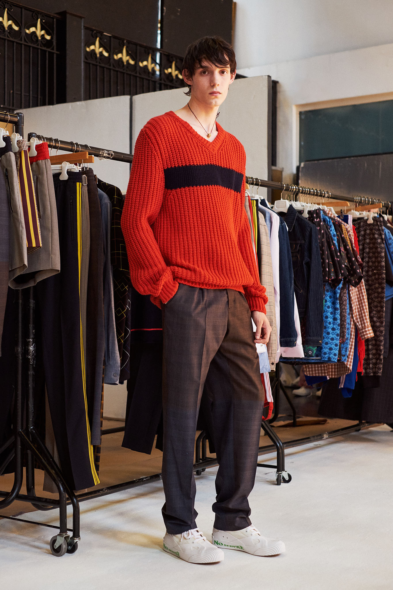 A model in a Stella McCartney Men's Spring 2018 look.