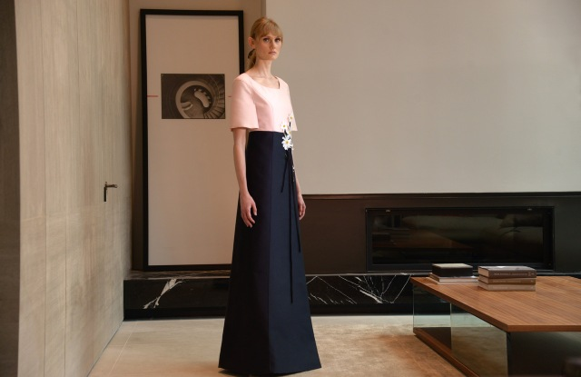 A powder pink and midnight blue silk and wool gown with embroidered daisies from Atelier Caito for Herve Pierre.