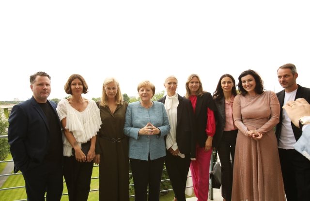 Angela Merkel (fourth from left) meets  Fashion Council Germany board members (from left) Scott Lipinski, Mandie Bienek, Marie Louise Berg, Christiane Arp, Claudia Hofman, Anita Tillman, and Markus Kurz, with state minister Dorothee Bär (second from  right).
