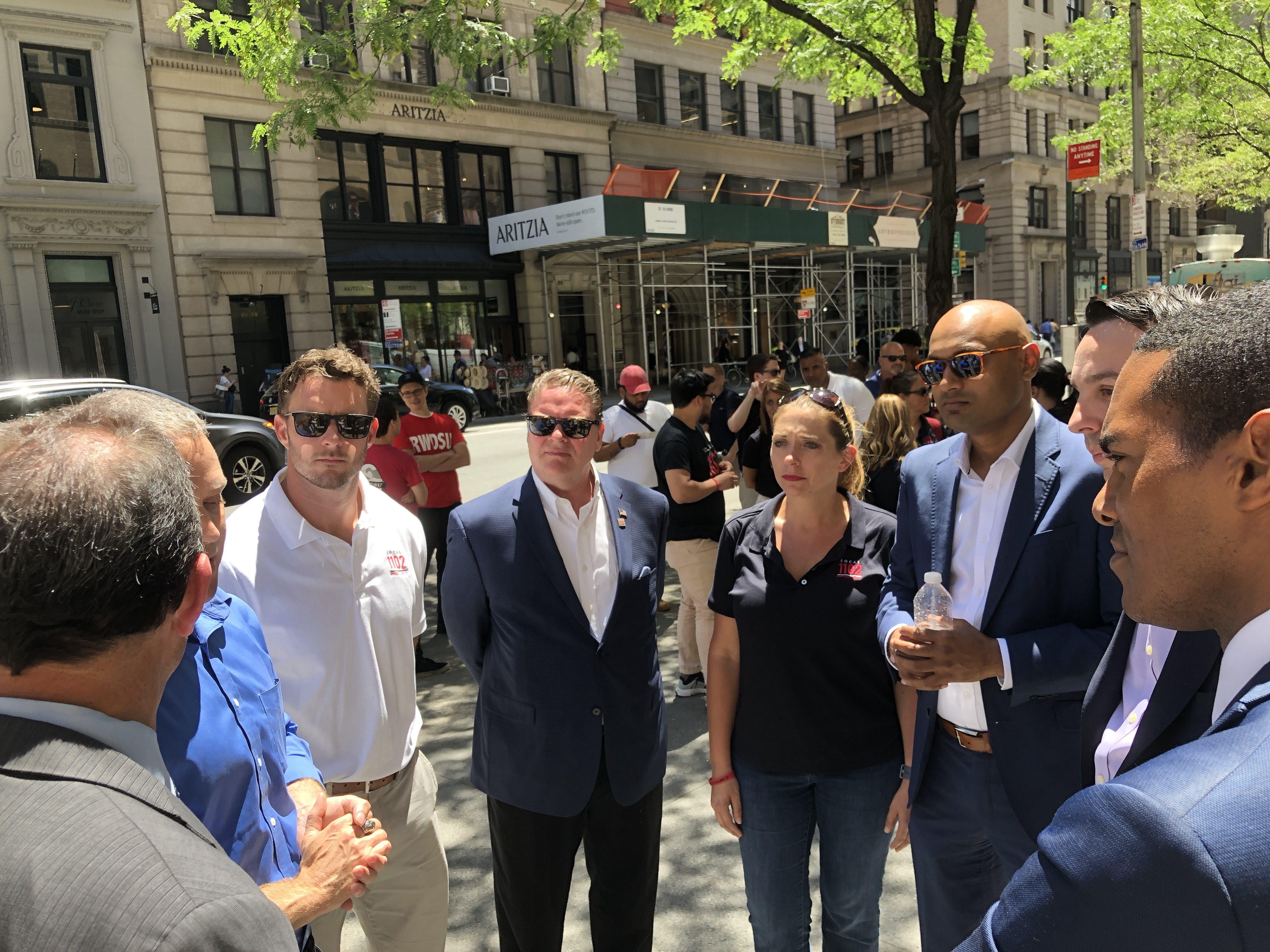Union supporters outside of H&M's New York office Thursday.