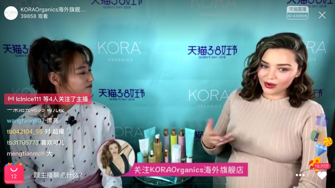 Model Miranda Kerr holds up a product from her cruelty-free beauty line Kora Organics. The brand ships to China via TMall.