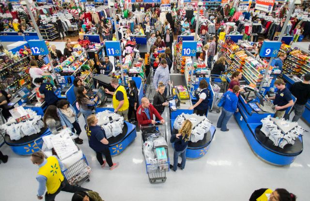 Customers leave happy from a Walmart store in Bentonville, AR, with their Black Friday items on . This year, Walmart stocked its digital and physical aisles with more than 1.5 million televisions, nearly two million tablets and computers and three million video gamesWalmart Thanksgiving shopping events, Bentonville, USA - 24 Nov 2016