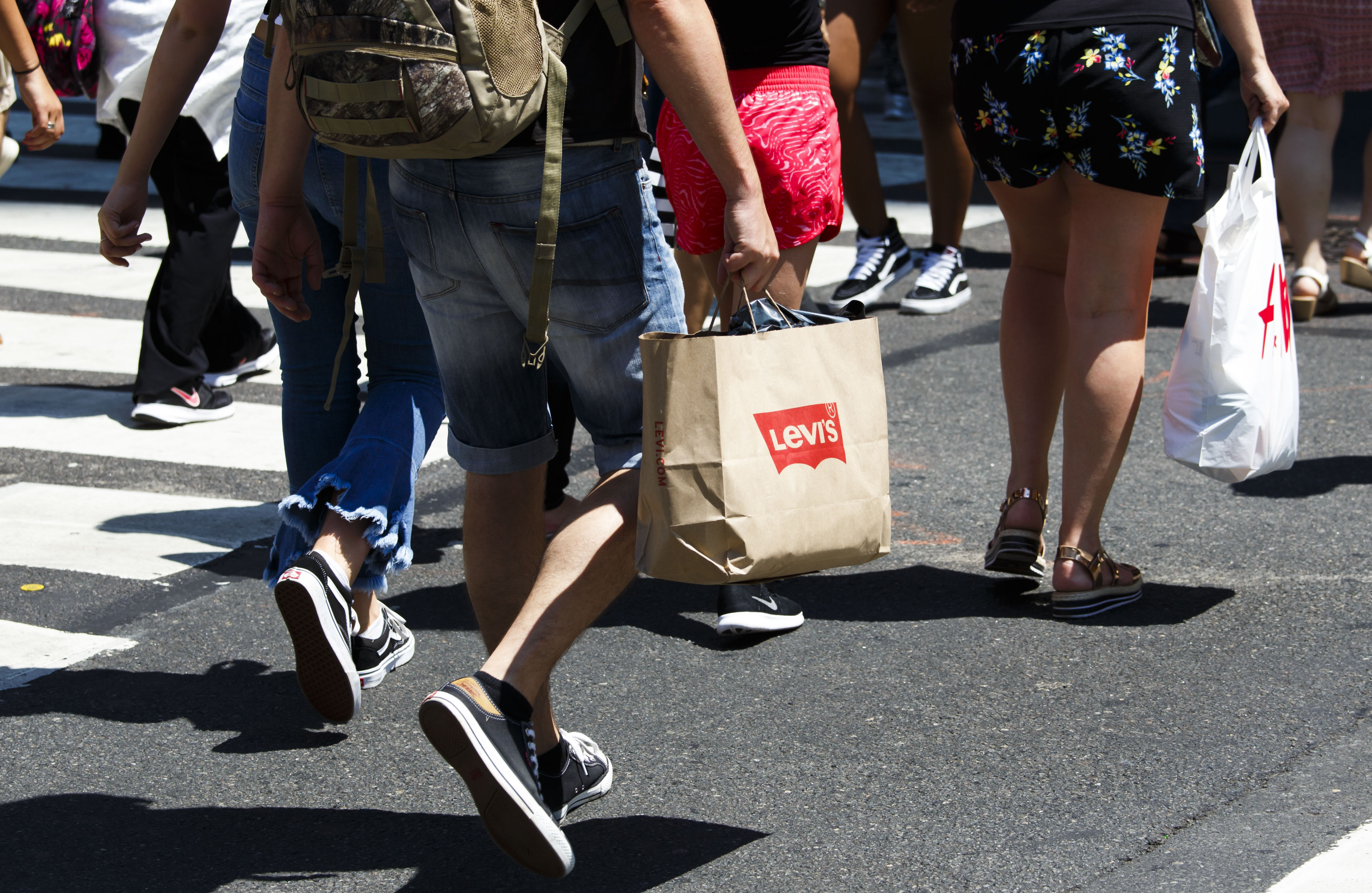 People carry shopping bags in New York, New York, USA, 01 August 2017. A report released today by the United States' Commerce Department showed moderate consumer spending growth in June of this year.US Consumer Spending, New York, USA - 01 Aug 2017