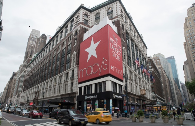 Traffic makes it's way past the Macy's flagship store, in New York. The company reported its second straight quarter of higher sales at existing stores after a three-year funk. Its shares surged nearly 9 percent Wednesday, and the stocks of other department store chains rose as wellEarns Macys, New York, USA - 16 May 2018