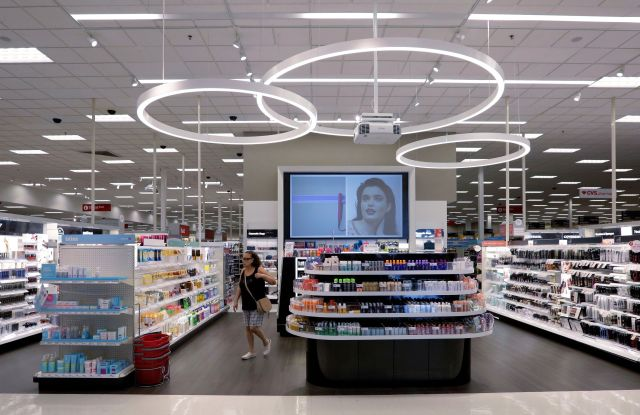 A shopper walks through the updated cosmetic department at a Target store in San Antonio. Success of specialty chains like Sephora and Ulta has pushed discounters like Walmart and Target as well as drugstores like CVS to revamp their cosmetics areas with more open spaces, brighter lighting and more attractive fixturesBeauty Battle, San Antonio, USA - 30 May 2018