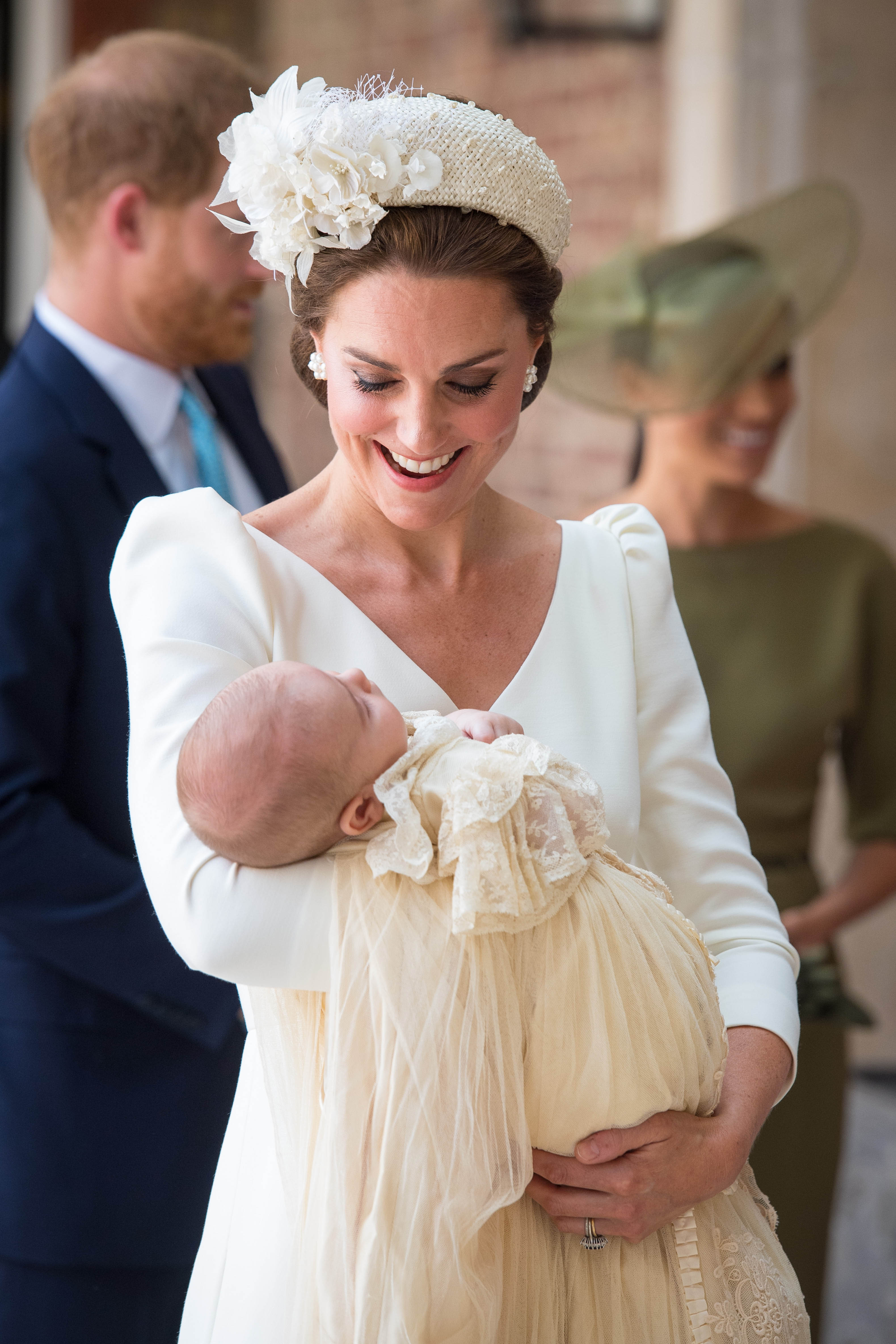 Catherine Duchess of Cambridge carries Prince Louis as they arrive for his christening service at the Chapel Royal, St James's Palace