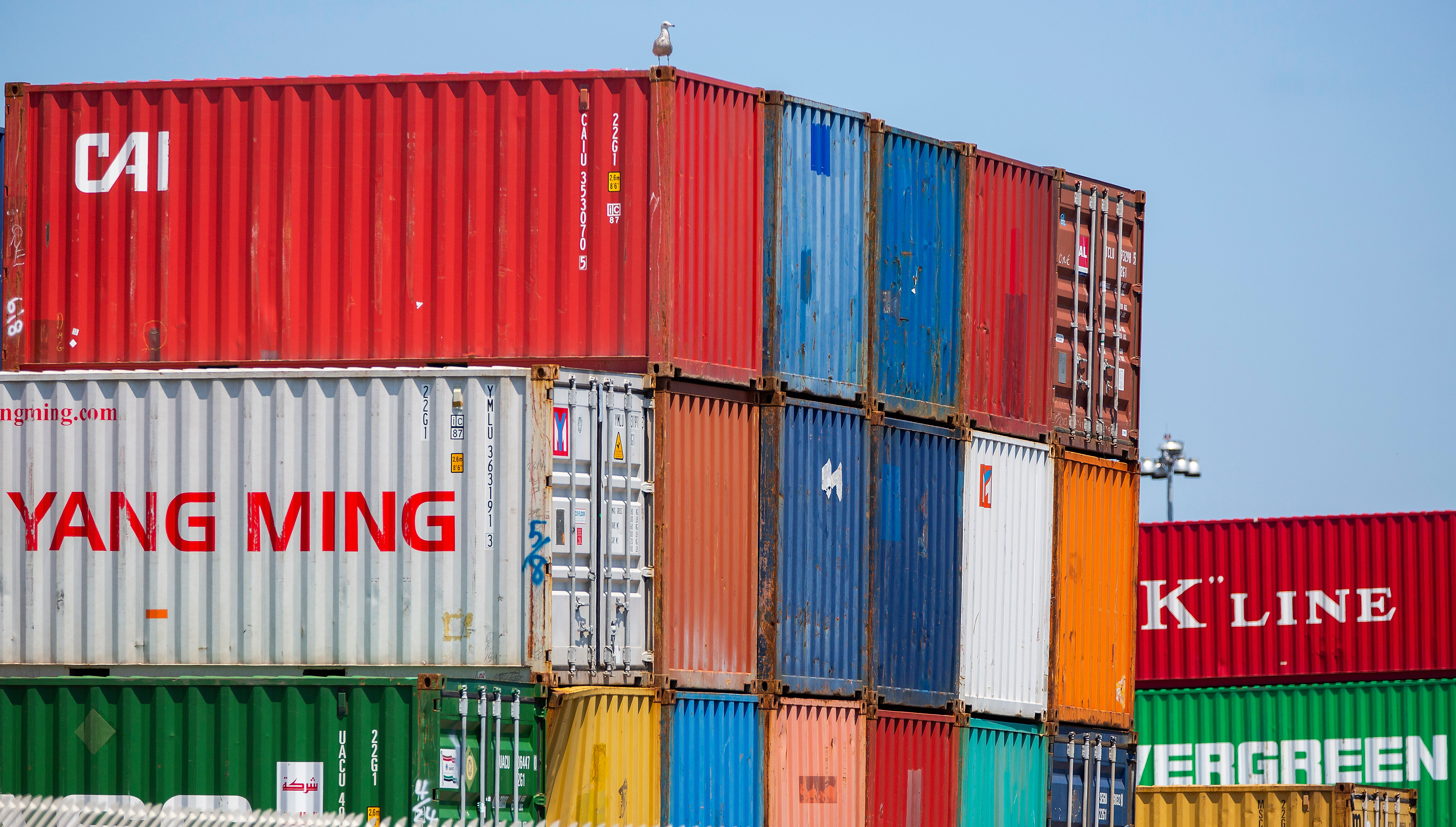 Chinese shipping containers sit at a U.S. dock.