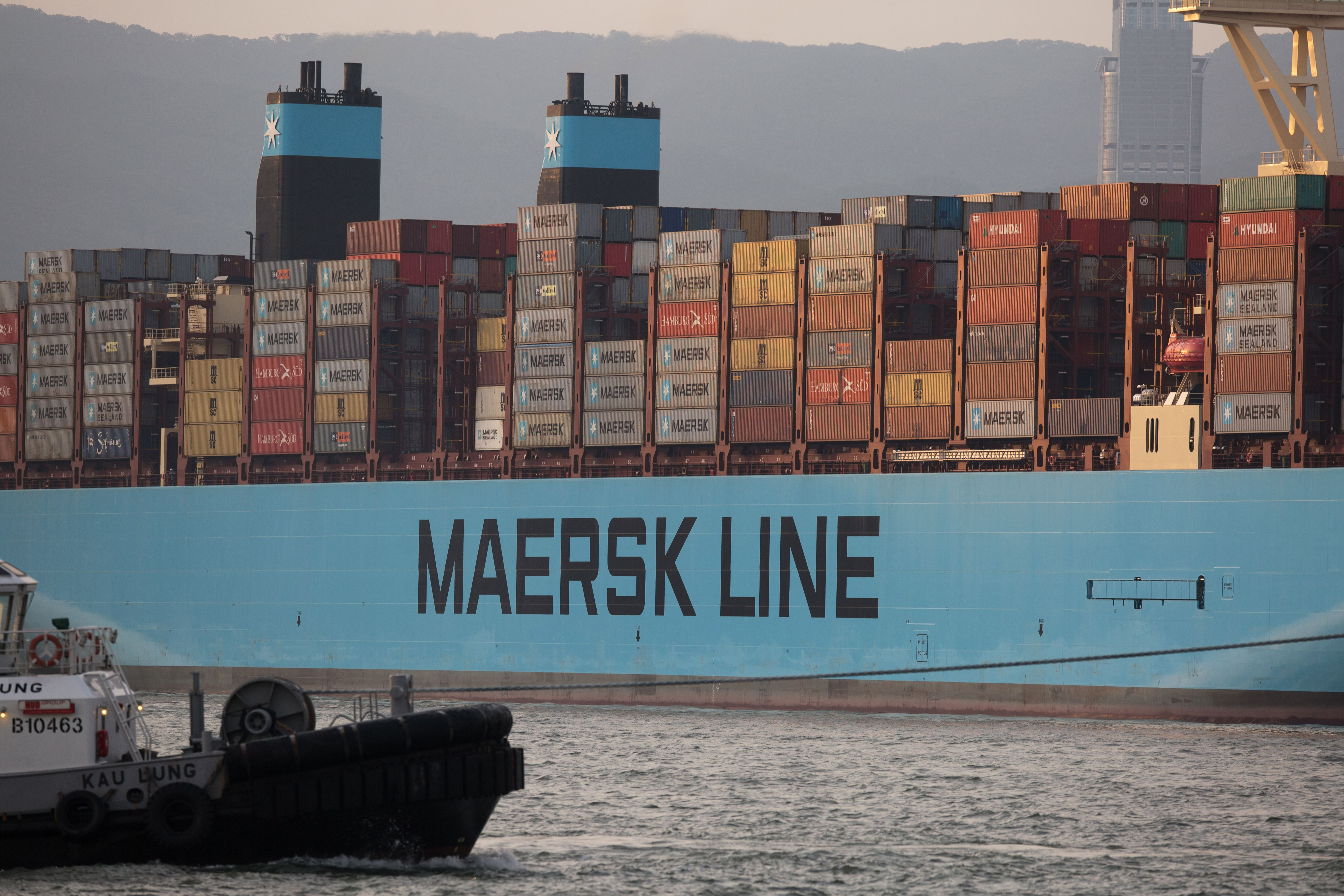 A container ships sails to the Kwai Tsing Container Terminals in Hong Kong, 11 July 2018. According to reports, Hong Kong's finance minister Paul Chan said the short-term impact on the city of China's escalating trade war with the United States would be limited to a dip in growth of just 0.1 or 0.2 of a percentage point. According to reports, US President Donald Trump announced on 10 July that US is preparing to impose 10 percent tariffs worth 200 billion US dollars on imported goods from China.A container ships sails the East lamma Channel, Hong Kong, China - 11 Jul 2018