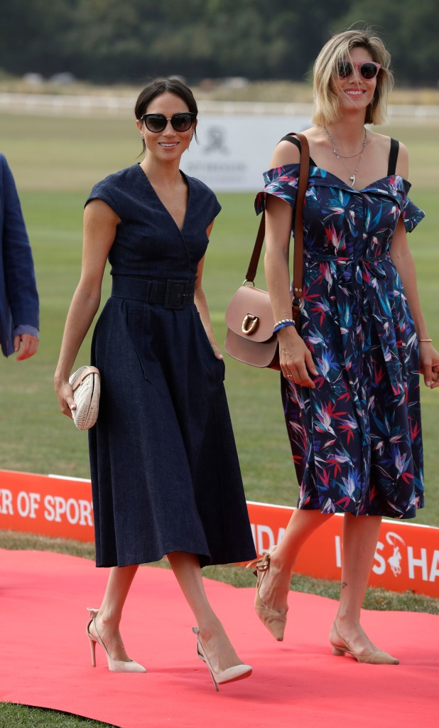 Meghan, Duchess of Sussex arrives with Delfina Blaquier, the wife of Nacho Figueras at the Royal County of Berkshire Polo Club in Windsor, England, to watch the Sentebale Polo Cup