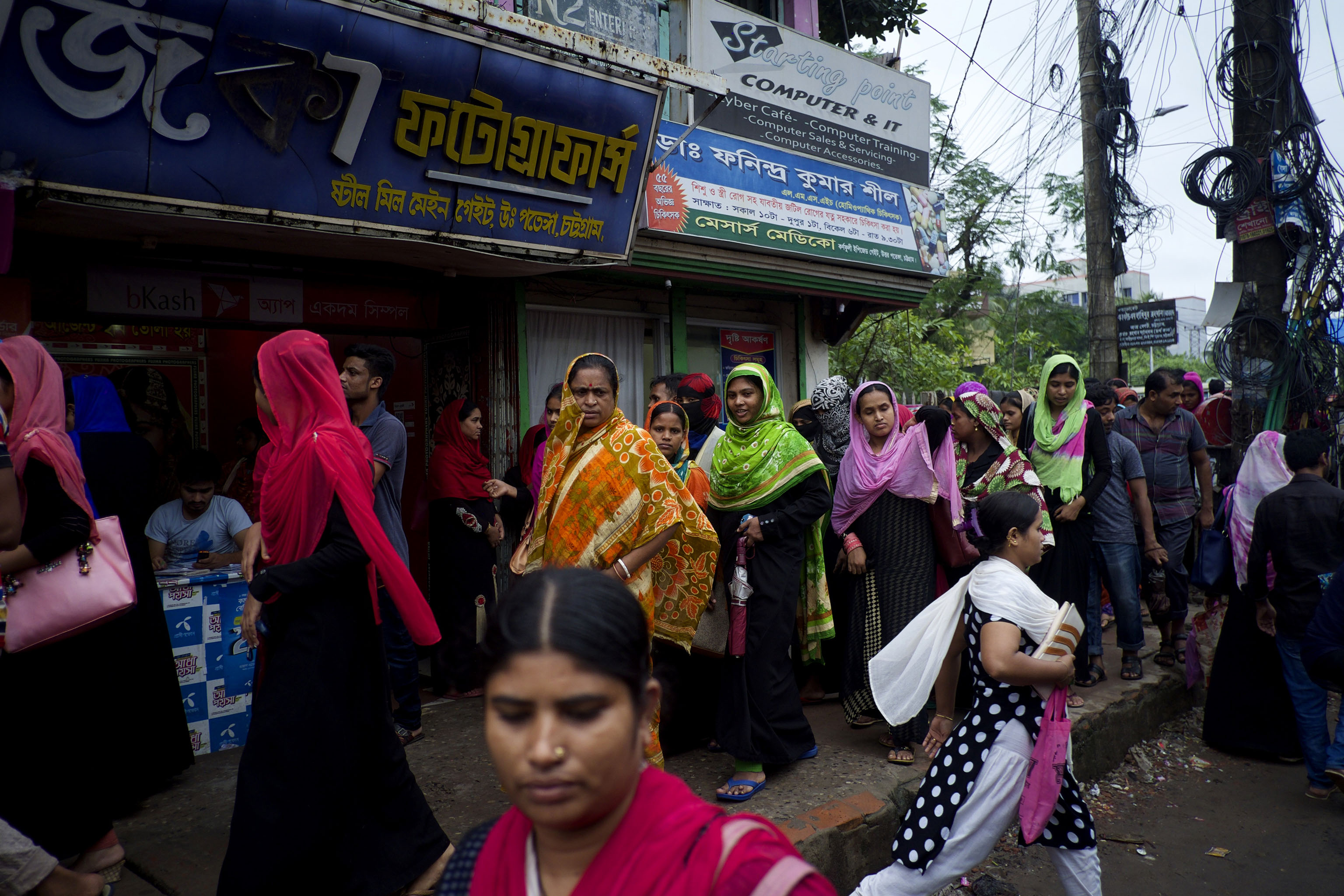 Masses of women leave their factories at the end of the day in Chittagong, southern Bangladesh. This region has more than 500,000 people employed in its garment sector.