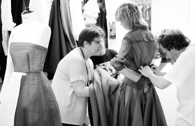 Florence Chehet and her team adjust a dress in the Dior couture workshop.