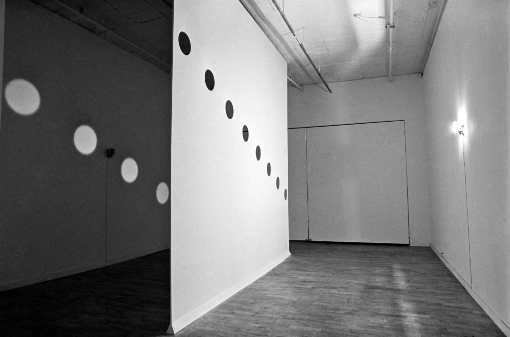HOLES OF LIGHT Nancy Holt, 1973 650 watt quart lights, poly-urethane board, pencil L:27' W:20' H:141⁄2' LoGiudice Gallery, N.Y.