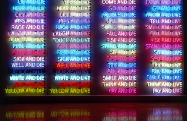 Bruce Nauman. One Hundred Live and Die. 1984. Neon tubing with clear glass tubing on metal monolith, 118 × 132 1/4 × 21″ (299.7 × 335.9 × 53.3 cm). Collection of Benesse Holdings, Inc./Benesse House Museum, Naoshima. © 2018 Bruce Nauman/Artists Rights Society (ARS), New York. Photo: Dorothy Zeidman, courtesy the artist and Sperone Westwater, New York